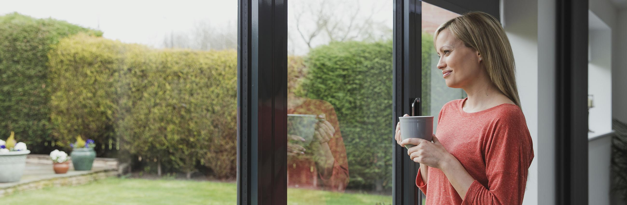 Woman standing in front of UPVC Doors